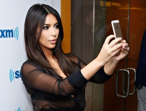 NEW YORK, NY - AUGUST 11:  (EXCLUSIVE COVERAGE/SPECIAL RATES APPLY)  TV personality Kim Kardashian takes a selfie at the SiriusXM Studios on August 11, 2014 in New York City.  (Photo by Cindy Ord/Getty Images)